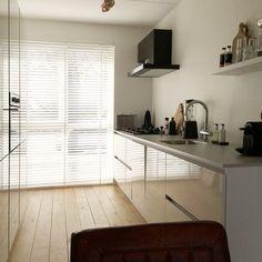 Parallel keuken met hoge kasten