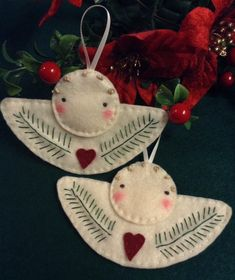 """Embroidered Angel Ornament is 5"""" by 3"""" and is all hand stitched. Available at Rooster and Bean Etsy."""