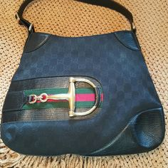 Gucci Handbag Sophisticated double G monogram on body  with large Gucci gold emblem. Timeless classic in excellent condition. Sparingly used.   Adjustable strap. 13x10x1. Perfect size for day or evening. Authentic, and can show you the tag inside.  More pics upon request!. Gucci Bags Shoulder Bags