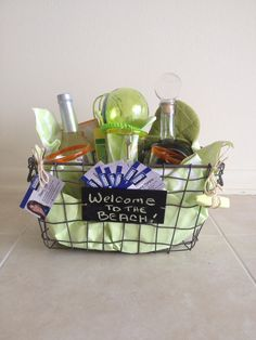 Beautiful basket with lots of goodies.... Tequila, The Palm Restaurant margarita mixer, Mexican hand blown glasses, kitchen towels, pot holders, and fun:)