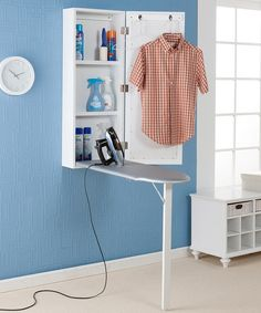 White Wall-Mounted Ironing Center - make it into wall decor and it'd be a lot more attractive and incredibly functional!