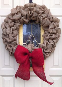 Burlap wreath with red bow for Christmas decoration