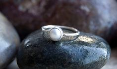 A white cultured pearl has been bezel set in sterling silver. A simple description for a simple but beautiful ring. This will look lovely on your Silver Pearl Ring, Silver Pearls, Stackable Rings, Cultured Pearls, Beautiful Rings, Gemstone Rings, Gemstones, Sterling Silver, Trending Outfits