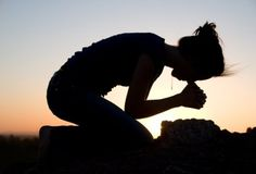 silhouettes of females in prayer | female+silhouette+kneeling+in+prayer.jpg