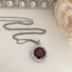 Garnet stone set in white gold with 27 diamonds