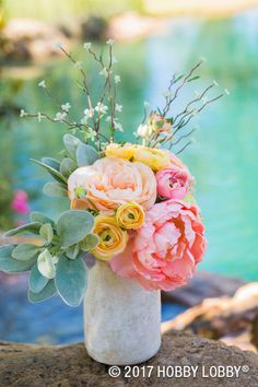 Pretty spring flowers placed in a simple container make the perfect centerpiece!