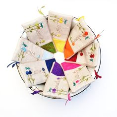 A colorful cluster of personalized clutches (the perfect bridesmaid gift).