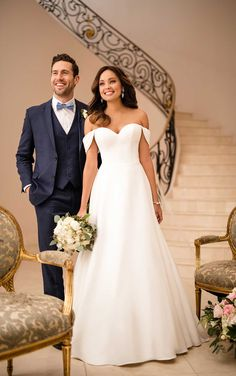 Feel like the belle of the ball in this incredibly beautiful wedding dress by designer Stella York. This new dove satin wedding dress has a romantic sensibility that can't be beat. Lovely off-the-shoulder straps that drape elegantly down the bride's arms come as a detachable accessory.