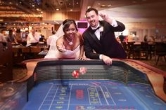 Action at the Craps Table Shot! Casey and Mo's Hot Pink Flamingo Chapel Wedding from Bently and Wilson Photography // Featured on Little Vegas Wedding