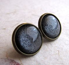 Gunmetal Gray Earrings - Antiqued Brass - Fake Plugs Faux Gauges. $16.00, via Etsy.