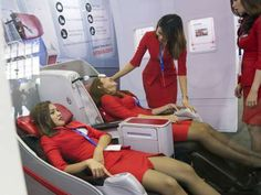 Members of AirAsia Bhd. cabin crew - Charles Pertwee/Bloomberg Tight Pencil Skirt, Tight Skirts, Air Hostess Uniform, Flight Attendant Hot, Mode Pin Up, Flight Girls, Delta Flight, Airline Uniforms, Rock Outfits