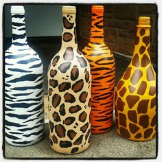 Animal print painted wine bottles.