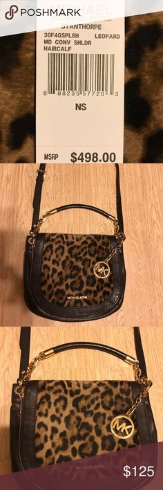 Michael Kors Calf Hair and Leather Crossbody Michael Kors brown leather and calf hair cross body purse. In excellent used condition. KORS Michael Kors Bags Crossbody Bags