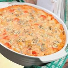 Buffalo Chicken Casserole  INGREDIENTS:  12 ounces whole-wheat elbow noodles 2 tablespoons canola oil 3 medium carrots, sliced 3 medium stalks celery, sliced 1 large onion, chopped 1 tablespoon minced garlic 2 pounds boneless, skinless chicken breast, trimmed and cut into 1-inch cubes 1/3 cup cornstarch 4 cups low-fat milk 1/8 teaspoon salt 5 tablespoons hot sauce, preferably Frank's RedHot 3/4 cup crumbled blue cheese (about 4 ounces)  PREPARATION  1. Preheat oven to 400°F. 2. Bring a Dutch…