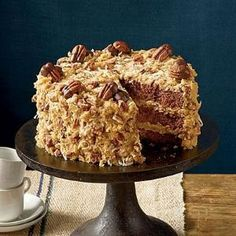 Mama's German Chocolate Cake | Bake a cake that would make mama proud. German chocolate cakes are known for being rich and indulgent, so enjoy a slice with a glass of milk. by DeeDeeBean