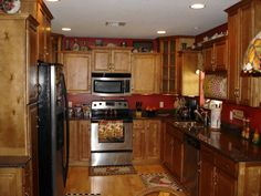 Kitchen, : Gorgeous U Shape Kitchen Decoration Using Solid Oak Wood Kitchen Cabinet Along With Red Kitchen Wall Paint And Black Granite Counter Tops