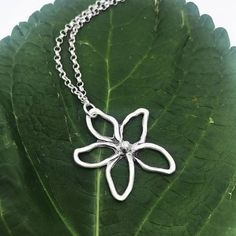 This unique silver flower necklace is made of fine silver (.999) and is hand drawn for a flirty style. A fun necklace that is finished with a sterling silver chain that measures about 17. In my designs you will see the evidence of hand work in the little imperfections. These