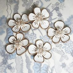 This is a lot of 12 Cute tiny flower buttons with shanks for sewing, for dainty jewelry making, and for creating embellishments and accessories.These buttons have very large and square 8 mm shanks.- 10 mm- White and gold colors.- Made from res... Button Flowers, Tiny Flowers, Large Flowers, Fancy Buttons, Diy Accessories, Dainty Jewelry, Flower Shape, Vintage Brooches, Hair Bows