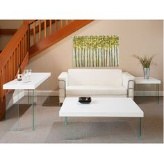 The Connor Console Table features a wenge or glossy white top resting on unique thick tempered clear glass legs. It is perfect for use behind a sofa, along an empty wall, or in an entryway. A matching side table, cocktail table, desk, and two dining tables are also available. $529.00