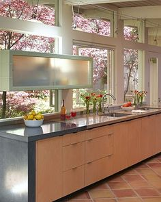 Floating cabinet - gorgeous cherry blossoms thru the windows