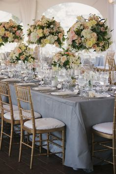Wedding Table Decor - Lots and lots of flowers     Photography: Stephanie Williams