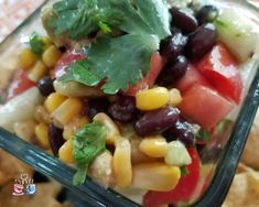 Black Bean and Corn Salad with tomato and avocado is often also called Cowboy Caviar! Check out our Low SmartPoint recipe and easy to make homemade snack!