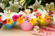 Small Mixed Garden Flower Arrangements Including Lilies (Lilium) and Nasturtiums (Nasturtiums) in Coloured Bowl Vases