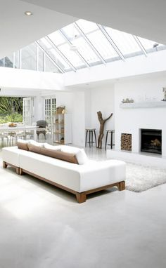 Natural, white, bright living! Love the light and wooden details!
