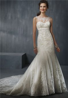 Net and satin fit and flare gown featuring a sheer yoke, sweetheart neckline, and satin empire waistband.  The entire gown has been accented throughout with crystal beaded embroidery down through the semi-cathedral train.