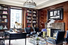 At the New York City home of a prominent art collector, the study is filled with vintage furnishings, including an Art Deco desk from Karl Kemp Antiques.  http://georgiapapadon.com/