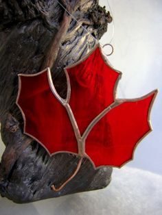 Red stained glass maple leaf ornament. #ExploreCanada #Canada