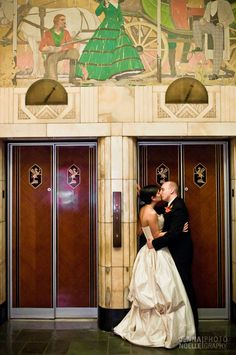 Brown Palace Denver Wedding; the architecture and her dress are really pretty
