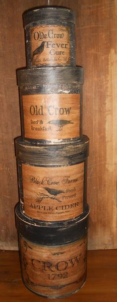 Set Of Four Paper Mache Boxes With Paper Crow Labels.