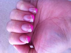 Acrylic nails, with sparkle tips with pink and more sparkles!