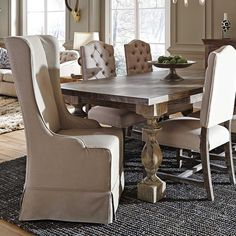 """The sleek, slip-covered Melrose Wingback Chair will add a contemporary touch to your dining table. A 100% linen cover wraps a solid birch wood frame. Melrose wingback chair. 23""""W x 28""""D x 47""""H"""