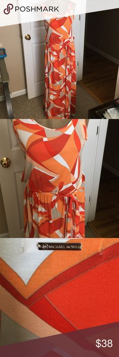 Michael Kors Confection This is a fabulous Michael Kors multicolor maxi dress. This dress is smooth and silky material has the Michael Kors logo name plate on the back. Deliciously belted this will drape your body beautifully! The colors are beige/taupe, white, orange, rust and melon very nice mix of color. MICHAEL Michael Kors Dresses Maxi