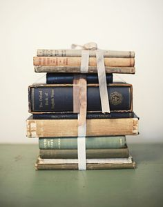 Vintage books can be used for so much more than just to fill a bookcase—one of my favorite decor pieces are old books!
