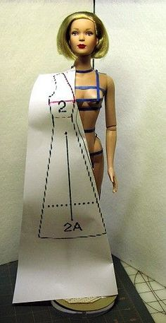 Sewing doll clothes using the instruction sheet diagrams from sewing patterns.  Clever.  Maybe a bit *too* clever.