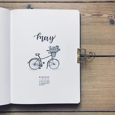 Bullet journal monthly cover page, May cover page, bicycle drawing, flower doodles, bicycle with flowers in basket drawing. | @bujobeyond