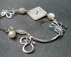 zia's button, petite beautiful bracelet of silver with mother of pearl buttons and wire scrollwork