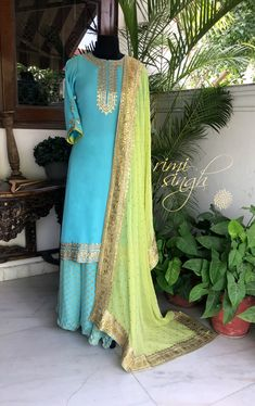 Life is not measured by the number of breaths we take, but by the moments that take our breath away... Sky blue georgette sharara teamed with a parrot green georgette dupatta with gota hand embroidery. There is gota hand embroidery on the neckline, sleeve and the kurta edge. Available exclusively at A 999 Sushant Lok 1 Gurgaon #9818310054