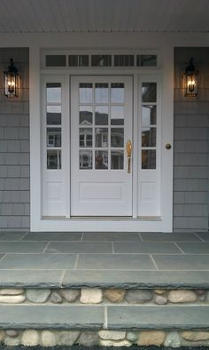 white front door with sidelights. Transome And Sidelites With Wood French Front Door Painted White. Bluestone River Rock. Black Carriage Lamps, Gold Hardware Seashell Doorbell. White Sidelights N