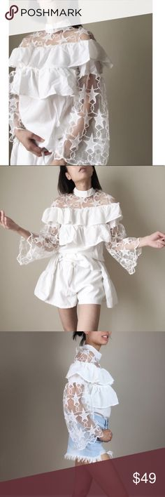 """Sonia Ruffle top with star appliqués. White chiffon like top with stars appliqué. Two tier ruffle with button top (back).flare sleeve with starry appliquésfront and back. High fashion statement piece .top quality polyblend and appliqués.size S. Limited stock only.Bust 34"""", length20"""" .. long flare sleeve19"""". Short pants on cover shot not included. Only for styling.Follow me onINSTAGRAM: @chic_bomband FACEBOOK: @thechicbomb CHICBOMB Tops Blouses"""