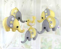 Baby Mobile Cot mobile Nursery decor Baby boy by BlueOwlHome Bring smiles and sweet dreams to your little bundle of joy with these adorable handmade baby mobiles. This elephant mobile makes great nursery decoration and is a perfect gift to bring to a baby shower. As a bonus, mobile plushies are detachable, and can be switched out anytime you want a little variety.