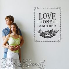A beautifully custom designed vinyl wall and window decal that reads Love One Another St. John 13:34