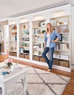 Awesome DIY Library Wall for Less Than $600. Kristen used IKEA Billy Bookshelves and added trim. BHG Style Spotters