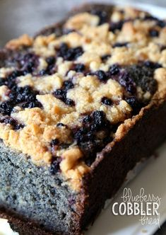 A soft, delicious quick bread that is LOADED with blue… Blueberry Cobbler Bread. A soft, delicious quick bread that is LOADED with blueberries and topped with a delicious crumble/cobbler topping! Köstliche Desserts, Delicious Desserts, Dessert Recipes, Yummy Food, Plated Desserts, Dinner Recipes, Blueberry Cobbler, Blueberry Recipes, Blueberry Bread