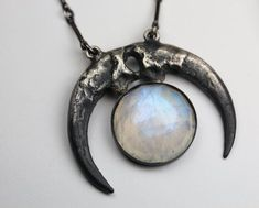 Hecate's Diadem necklace. Cast owl talons in sterling silver and rose cut moonstone. Blood Milk