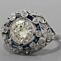 This exotic antique engagement ring does look very antique but stylish and classy at the same time. This antique engagement ring in platinum with sapphires in Antique Wedding Rings, Antique Engagement Rings, Vintage Rings, Vintage Jewelry, Antique Jewelry, Wedding Vintage, Deco Engagement Ring, Diamond Engagement Rings, Diamond Rings