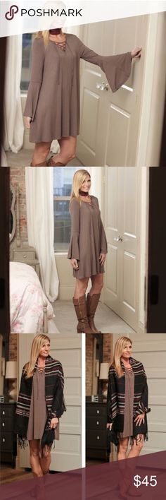 Taupe bell sleeve dress Super cute for any season! Flowy fit with bell sleeves and a trendy lace up front! Taupe is the only color available at the moment. Please let me know if you have any questions!  Infinity Raine Dresses Long Sleeve